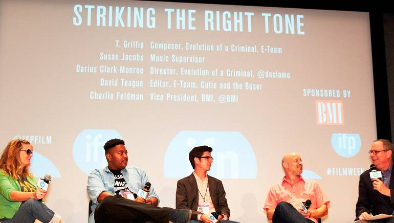 """Panelists and moderator engaged in conversation at the """"Striking the Right Tone"""