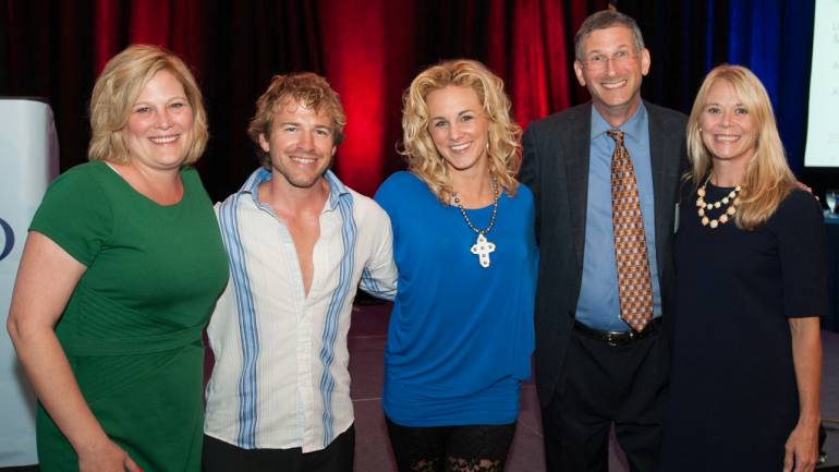 Pictured after her performance (l-r): NCAB Executive Director Lisa Reynolds, North Carolina guitarist Joey Boardwine, BMI songwriter Adley Stump, NCAB President and VP/GM of WRAL-TV Steve Hammel and BMI's Amy Perdue.