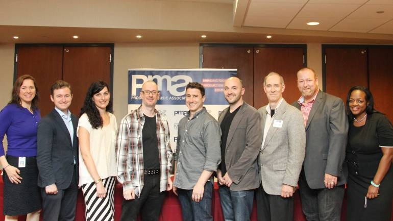 The panelists and BMI representatives behind
