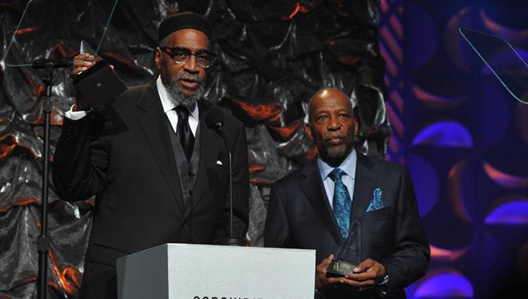 Legendary BMI songwriters Kenneth Gamble and Leon Huff accept the Johnny Mercer Award at the 2014 Songwriters Hall of Fame Gala.