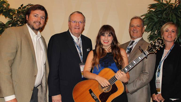 Pictured (L-R) before the performance are: BMI's Mason Hunter, TAB Board Chairman and WDEF-TV Chattanooga General Manager Phil Cox, Caitlyn Smith, TAB Executive Director Whit Adamson, and TAB Board Director-at-Large-Radio and 5 Star Radio Group President and General Manager Katie Gambill.