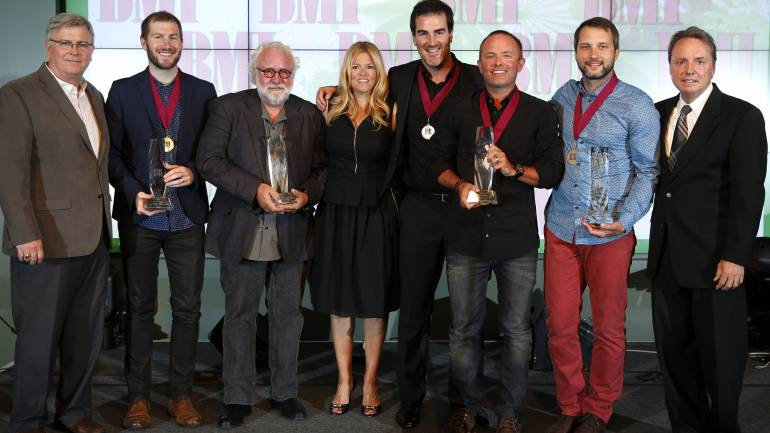 The night's big winners gather for a photo at the 2014 BMI Christian Awards in Nashville. Pictured are (l-r): BMI's Phil Graham, Song of the Year writer Scott Cash, Publisher of the Year Eddie DeGarmo of Capitol CMG Publishing, BMI's Leslie Roberts, Song of the Year writer Ed Cash, Songwriter of the Year and Song of the Year writer Chris Tomlin, Songwriter of the Year Brandon Heath, and BMI's Jody Williams.