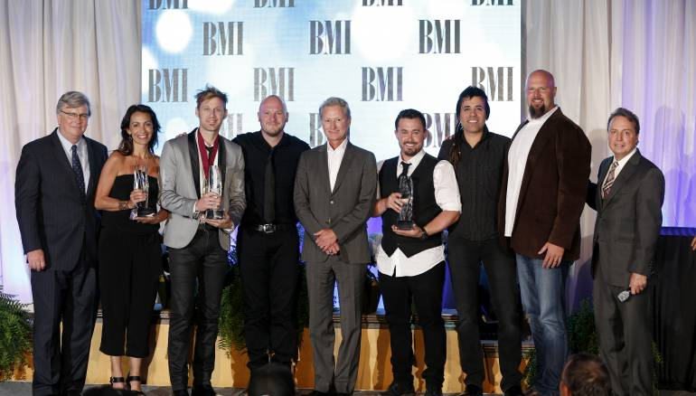 "A look back at 2013: Building 429 accepts their Song of the Year award for ""Where I Belong"" at the 2013 BMI Christian Music Awards. Pictured are (l-r): BMI's Phil Graham, Provident Music Group's Holly Zabk, Building 429's Jason Roy and Aaron Branch, Provident Music Group's Terry Hemmings, Building 429's Michael Anderson and Jesse Garcia, Provident Music Group's Devon DeVries, and BMI's Jody Williams."