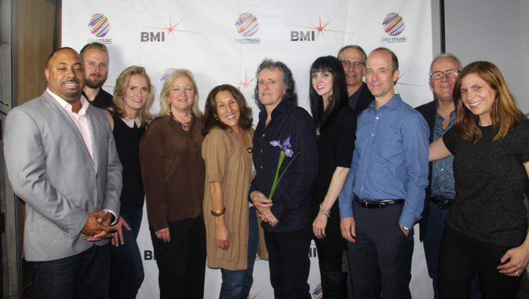 """Pictured (L-R): peermusic Senior Creative Director, Film and TV, Jerome Spence; BMI's Justin Seiser; peermusic President, Asia Pacific and Strategic Markets Mary Megan Peer; peermusic President and CEO — Anglo American Region Kathy Spanberger; BMI's Barbie Quinn; BMI singer-songwriter Donovan; peermusic Manager of Catalog Development Kara Wright; peermusic Senior Creative Director, Advertising Markets, Craig Currier; peermusic VP, Legal and Business Affairs, Tim Cohan; peermusic President, Europe and Managing Director, peermusic U.K., Nigel Elderton and BMI's Tracie Verlinde at BMI and peermusic's """"Peer Bliss"""" event on October 22, 2014, in Burbank, Calif."""