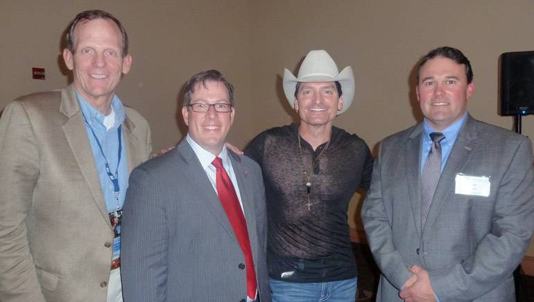 Pictured (L-R): BMI's Dan Spears, Retail Association of Maine Executive Director Curtis Picard, BMI songwriter George Ducas, Retail Association of Maine Board Chair and Kittery Trading Post VP Fox Keim.