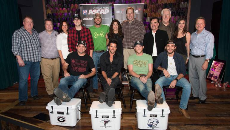 (L-R): Front Row: BMI songwriter Rhett Akins, Michael Carter, BMI songwriter Cole Swindell, artist Thomas Rhett. Back Row: ASCAP's Mike Sistad, BMI's Bradley Collins, ASCAP's LeAnn Phelan, producer Luke Laird, singer Luke Bryan, Red Light Management's Kerri Edwards, Sony/ATV's Tom Luteran, Big Machine's Scott Borchetta, Valory Music Company's George Briner, manager Virginia Davis and BMI's Jody Williams.