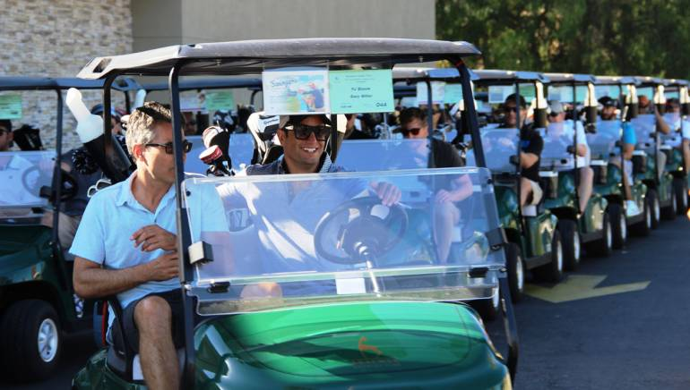 Universal Music Publishing's Gary Miller and music supervisor PJ Bloom lead the way to the golf course at BMI's fifth annual golf tournament, held on Aug. 18, 2014 at the Braemar Country Club in Tarzana, California.