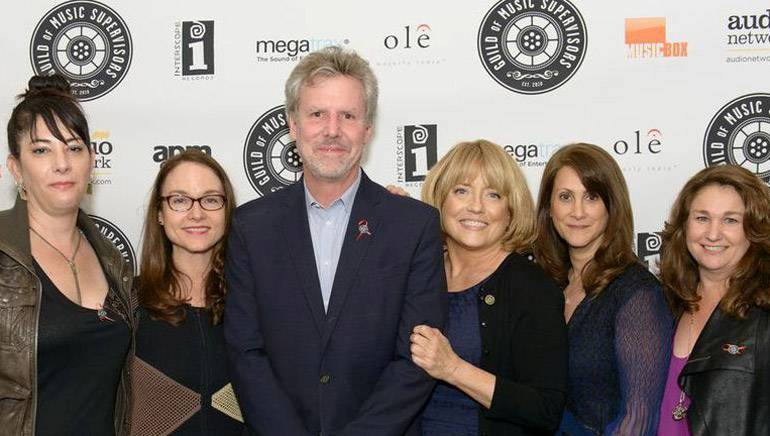Pictured L-R at the awards ceremony are: Music Supervisor Award nominee Amine Ramer, BMI Senior Director Film/TV Relations Lisa Feldman, Warner Brothers President of Music Paul Broucek, Guild President Maureen Crowe, Music Supervisor Award winner Robin Kaye and Disney's Vice President Creative of Music and Soundtracks Kaylin Frank.