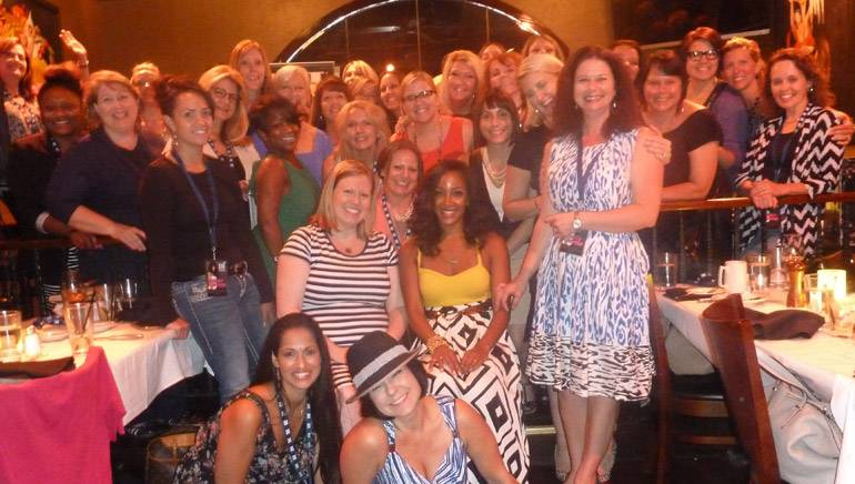 Featured performer Mickey Guyton pictured with the Rising Through the Ranks Class of 2014.