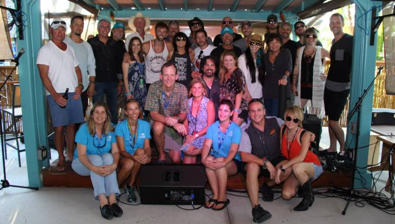 BMI's Dan Spears and David Claassen with the Fort Myers Beach songwriters and the staffs from the VCB and iHeart Media/Cat Country 107.1.