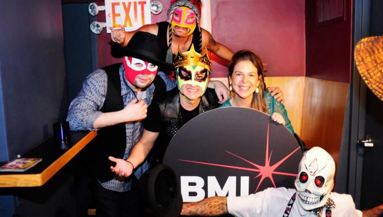 Los ChinchillosDel Caribe grab their masks and strike a pose backstage with BMI's Carolina Arenas at BMI's Verano Alternativo on July 7, 2014.