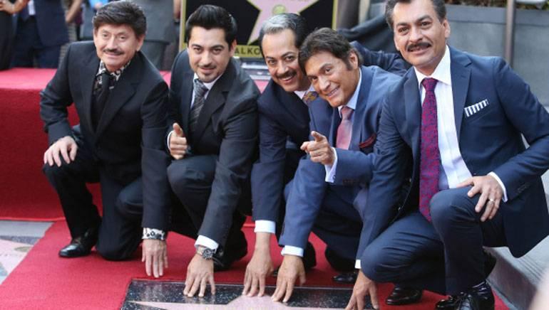 Pictured (L–R): Los Tigres del Norte members Oscar Lara, Luis Hernandez, Hernán Hernandez, Jorge Hernandez and Eduardo Hernandez, posing with their star on the Hollywood Walk of Fame.