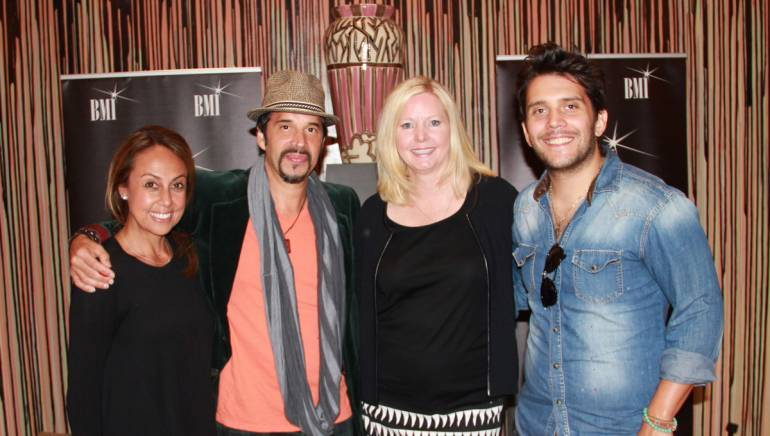 """BMI's Delia Orjuela, songwriter Elsten Torres, BMI's Nada Latto, and songwriter Gustavo Galindo pose before the two artists perform at """"Making Music Happen."""""""