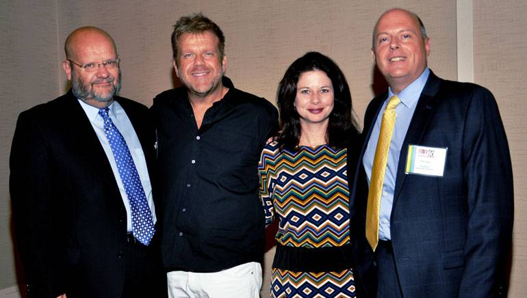 Pictured after the performance (l-r): NBA past-Chairman and owner/manager Platte Valley Radio Craig Eckert, Wendell Mobley, BMI's Jessica Frost and NBA President and Executive Director Jim Timm.
