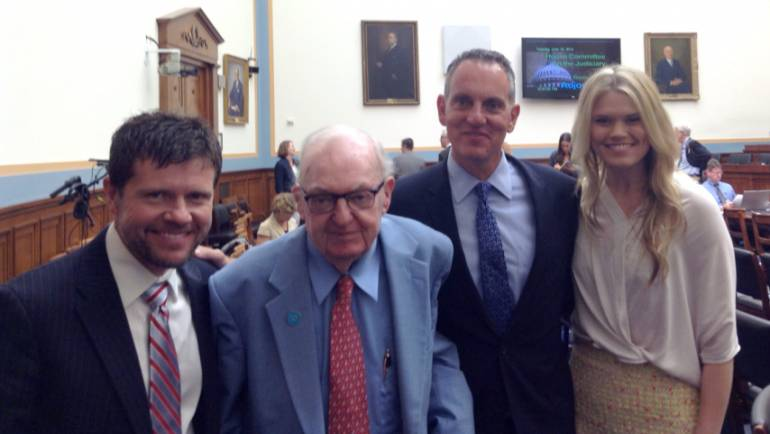 BMI songwriters Lee Thomas Miller (left) and Nicolle Galyon (right) pose with Michael O'Neill (second from right) and Chairman Coble (second from left) after the June 10 music licensing hearing.