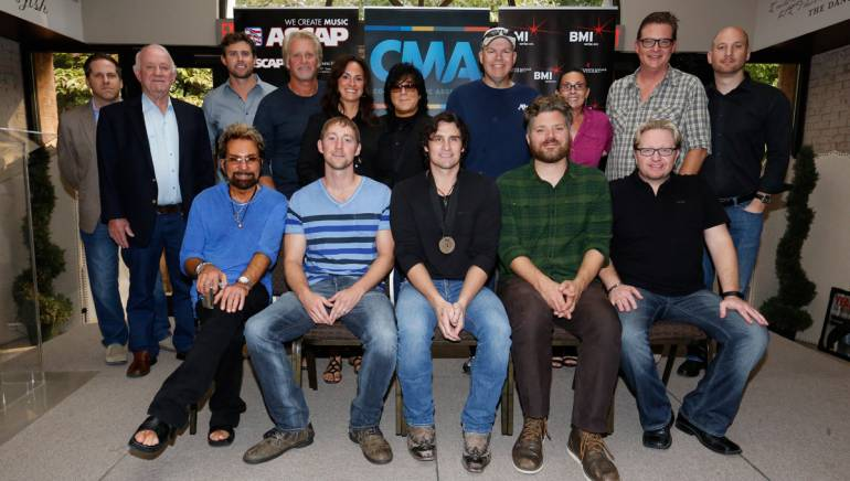 (L-R) (Front row): Producer Tony Brown, songwriter Ashley Gorley, Joe Nichols, BMI songwriter Bryan Simpson, Producer Mickey Jack Cones. (Back Row): Broken Bow Record's Jon Loba, Broken Bow Record's Benny Brown, Warner/Chappel Music's Ryan Beuschel, Combustion Music's Chris Farren, ASCAP's LeAnn Phelan, ASCAP's John Titta, Sea Gayle's Mike Owens, Red Bow Records' Renee' Leymon, BMI's Perry Howard, Triple 8 Management's George Couri.