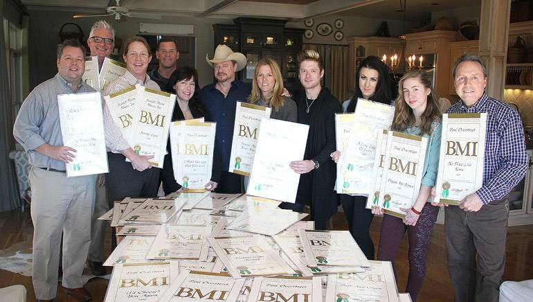 Pictured are BMI's Bradley Collins, Perry Howard, Clay Bradley, and Mark Mason; Overstreet's wife Julie Miller; Overstreet; BMI's Leslie Roberts; Overstreet's children Nash, Summer, and Charity; and BMI's Jody Williams.