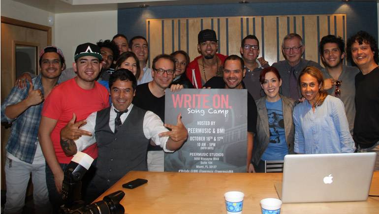 Pictured at the two-day songwriting camp at the peermusic office in Miami, Florida: Back row (L–R): Julca Brothers; Linkon; BMI Director, Latin Writer/Publisher Relations, Carolina Arenas; peermusic VP, Latin America Operations, Chema Escrina; Cynthia Bagué; Motiff; Juan Cristobal Losada; peermusic Chairman and CEO Ralph Peer II; Gustavo Galindo and Junior Cabral. Front row (L–R): Alcover; Bruno Danzza; peermusic VP, Latin Division East Coast and Puerto Rico, Julio Bagué; BMI Senior Director, Latin Writer/Publisher Relations, Joey Mercado; peermusic VP, Latin Division West Coast, Yvonne Drazan and BMI VP, Latin Writer/Publisher Relations, Delia Orjuela.