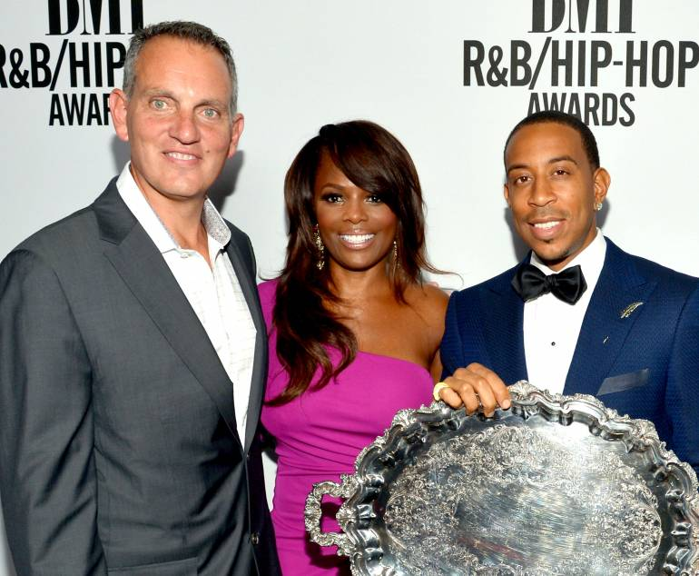 BMI President and CEO Michael O'Neill, BMI Vice President of Writer/Publisher Relations Catherine Brewton and honoree Chris 'Ludacris' Bridges (holding the BMI President's Award) attend the 2014 BMI R&B/Hip-Hop Awards at the Pantages Theatre on August 22, 2014 in Hollywood, California.