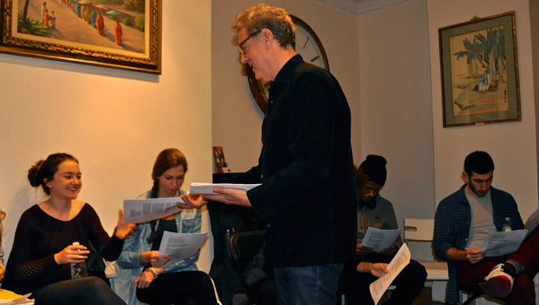 Instructor Billy Seidman hands out materials at his Song Arts Academy Workshop.