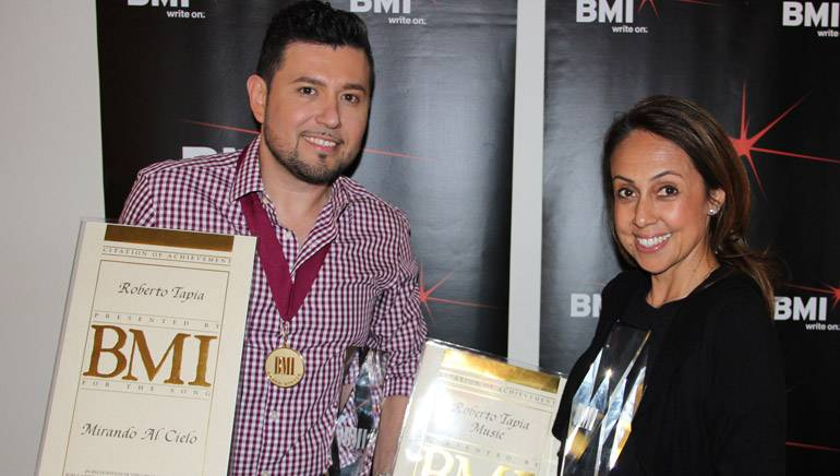 Pictured at BMI's Los Angeles office are: BMI songwriter and recording artist Roberto Tapia and BMI's Delia Orjuela.