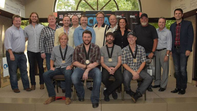 (L-R): (Back row) BMI's Bradley Collins; CMA's Brenden Oliver; ASCAP's Mike Sistad; This Music's Rusty Gaston; RCA Nashville's Josh Easler; Warner/Chappell's Ben Vaughn; Chairman, CEO, Sony Music Nashville Gary Overton; Sony/ATV Tree's Troy Tomlinson; ASCAP's LeAnn Phelan; Producer James Stroud; BMI's Jody Williams; and CMA's Damon Whiteside. (Front row): BMI songwriter Marv Green, Chris Young, BMI songwriter Paul Jenkins and co-writer Jason Sellers.