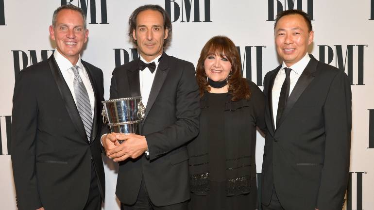 (L-R) BMI President and CEO Mike O'Neill, honoree Alexandre Desplat, BMI Vice President of Film and Television Relations Doreen Ringer-Ross and Assistant Vice President of Film and Television Relations at BMI Ray Yee pose with the BMI Icon Award during the 2015 BMI Film & Television Awards.