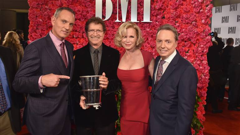 Pictured: (L-R): BMI's Mike O'Neill, BMI songwriter and Icon Mac Davis with his wife Lise Davis and BMI's Jody Williams.