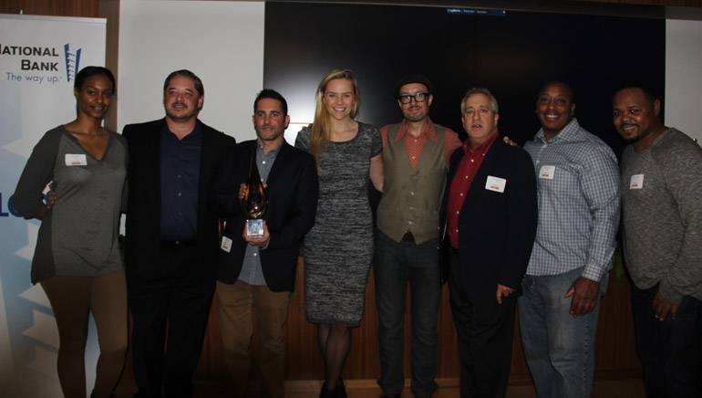 Pictured at the 2014 AIMP holiday party held at BMI's Los Angeles office (L–R): ole Office Coordinator Lauren Carter; ole MusicBox SVP Steven Karpowicz; ole VP, Business Development David Weitzman; ole Creative Manager Jennifer Essiembre; ole Senior Manager, Synch and Licensing, Brandon Schott; ole MusicBox Director Film/TV Music Licensing Andrew Robbins; ole | BlueStone Director, Eric Spence and Mosley Music Group President Marcus Spence.