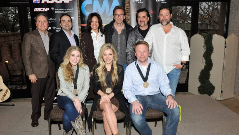 Pictured (L-R): Back row: BMI's Jody Williams, Big Machine Music's Mike Molinar, ASCAP's LeAnn Phelan, producer Dan Huff, Big Machine Label Group's Scott Borchetta and Dot Record's Chris Stacey. Front row: Songwriters Maddie Marlow, Tae Dye and BMI Songwriter Aaron Scherz.