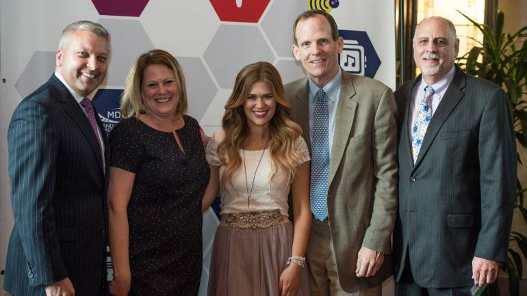 Pictured (L-R) after the performance are: WBAL-TV President/GM and MDCD Board Chair Dan Joerres, MDCD Executive Director Lisa Reynolds, BMI singer-songwriter Ruthie Collins, BMI's Dan Spears and WXCY-FM General Manager Bob Bloom.