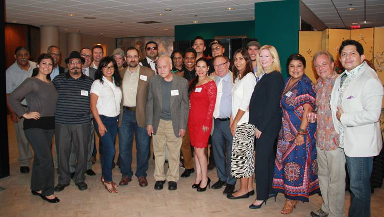 Members of Nashville's Latin Community and the BMI team pause during the meet and greet for a group shot.