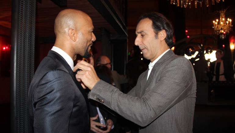 Pictured at the SCL reception on Saturday, February 21, 2015, at La Bohéme in West Hollywood, Calif. (L–R): 2015 Oscar winners Common and Alexandre Desplat.