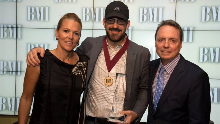 "BMI's Leslie Roberts (L) and Jody Williams (R) pose with Songwriter of the Year winner Chris Stevens. His most-played Christian radio hits include ""Beautiful Day,"" ""Overcomer"" and ""Slip On By."""