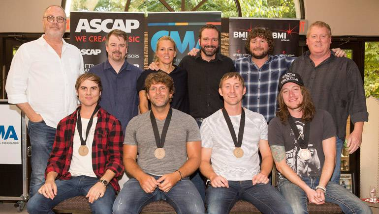 Pictured (L-R) back row: Universal Record's Mike Dungan, Amylase's Ben Vaughn, BMI's Leslie Roberts, Sony/ATV's Josh Van Valkenburg, Combustion Music's Chris VanBelkom and ASCAP's Mike Sistad. Front row: BMI songwriter Ross Copperman, Billy Currington, songwriters Ashley Gorley and Jaren Johnston.