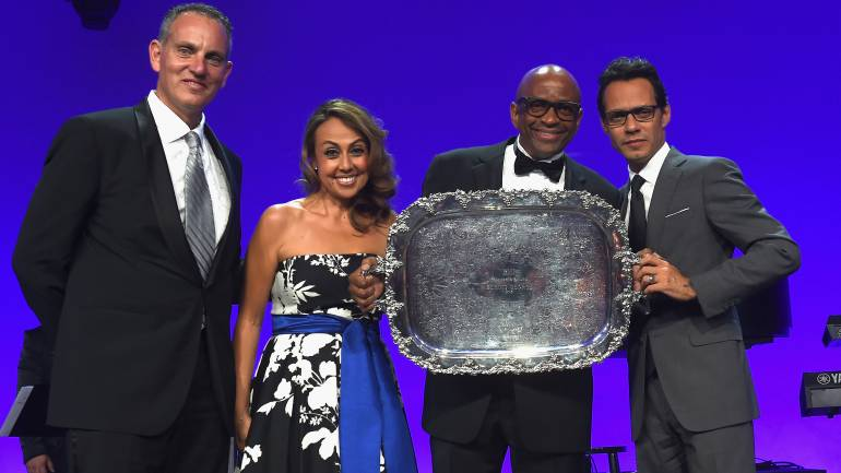 BMI President and CEO Mike O'Neill (L) and BMI Vice President, Latin Music Delia Orjuela (2nd from left) and Marc Anthony (far right) present producer, pianist and composer Sergio George with the 2015 BMI President's award at the 22nd annual BMI Latin Awards held at the Fontainebleau Hotel in Miami Beach, Florida.