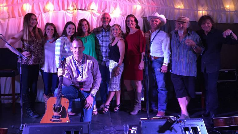 Standing (L-R):BMI songwriter Kylie Sackley,Sacajawea Hotel's Hailey Folkvord, Sacajawea Hotel Event Coordinator Emily Waugh, BMI songwriters Helen Darling and Billy Montana, Sacajawea Hotel's Hillary Folkvord,Sacajawea Hotel General Manager Brooke Leugers, Sacajawea Hotel owner Dean Folkvord and BMI songwriters Kostas and Even Stevens. (Kneeling): BMI's Dan Spears.