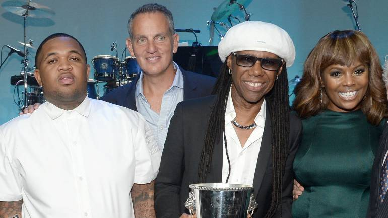 (L-R) Recording artist DJ Mustard, BMI President & CEO Mike O'Neill 2015 BMI Icon Award recipient Nile Rodgers and BMI Vice President, Writer/Publisher Relations, Atlanta, Catherine Brewton onstage at the 2015 BMI R&B/Hip-Hop Awards at Saban Theatre on August 28, 2015 in Beverly Hills, California.