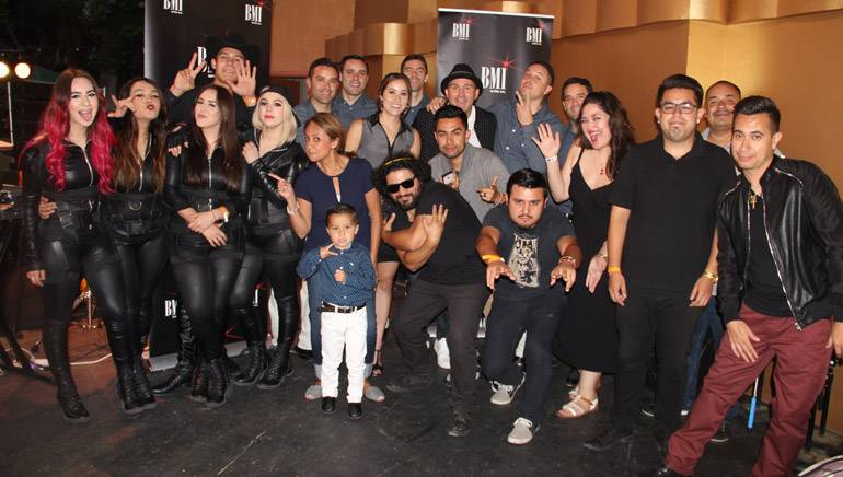 BMI's Delia Orjuela and Krystina DeLuna are surrounded by performers and team on August 7 at the BMI Summer Nights concert series presented by BMI and Levitt Pavillion at MacArthur Park in Los Angeles.