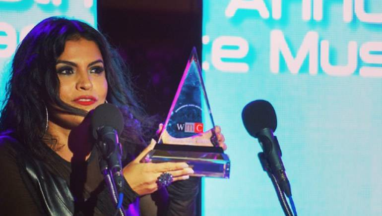 Vassy accepts her International Dance Music Award. The ceremony was held in Miami and recognizes the best dance music from the year.