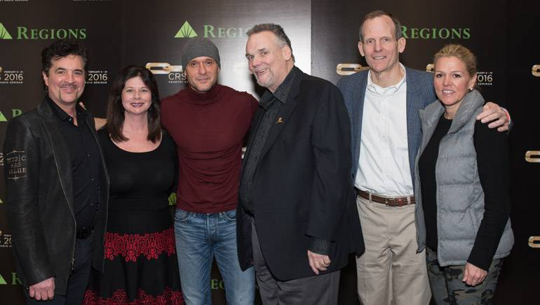 Big Machine Label Group President & CEO Scott Borchetta, BMI's Jessica Frost, BMI songwriter Tim McGraw, Country Radio Seminar Executive Director Bill Mayne and BMI's Dan Spears and Leslie Roberts pose for a photo during BMI's sponsored session at CRS in Nashville.