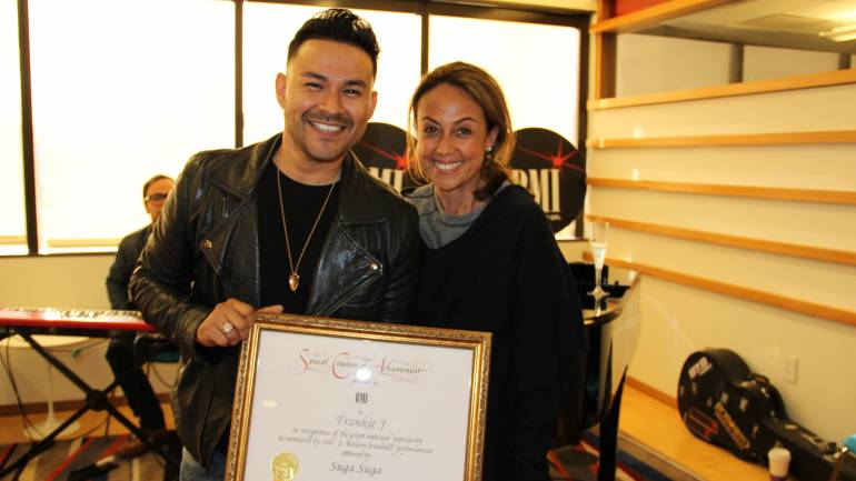 "Frankie J and BMI's Delia Orjuela after he was presented with the Special Certificate of Achievement for over 1 million broadcast performances of ""Suga Suga"""