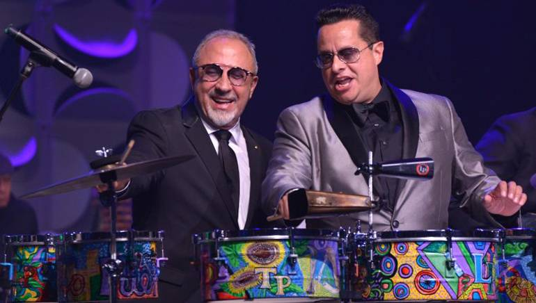 Emilio Estefan joins Tito Puente Jr. onstage at the Latin Songwriters Hall of Fame's 4th Annual 2016 La Musa Awards.