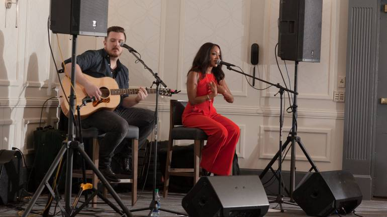 Guitarist Aaron Lagrone and Mickey Guyton during the performance.