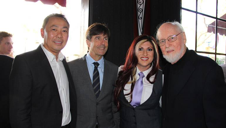 BMI Assistant Vice President of Film/TV Relations, Ray Yee; BMI composer Thomas Newman; BMI Director Film/TV Relations, Anne Cecere; and BMI Composer John Williams smile for a photo during the SCL Champagne Reception.