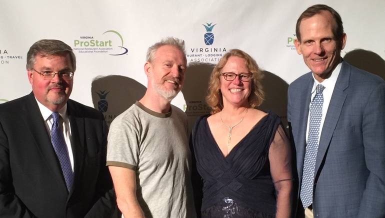 """Pictured (L-R) before BMI songwriter Chris Baron hit the stage at the Virginia Restaurant, Lodging and Travel Association's """"Ordinary Awards"""" are: VRLTA President and CEO Eric Terry, Chris Barron, Griffin Tavern & Restaurant owner and VRLTA Board Chair Debbie Donehey and BMI's Dan Spears."""