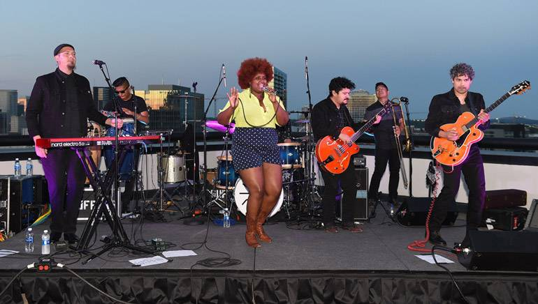 BMI band The Suffers performs as the sunsets on BMI's rooftop. BMI hosted an Americana Kickoff Party the day before the official Americana Festival began.