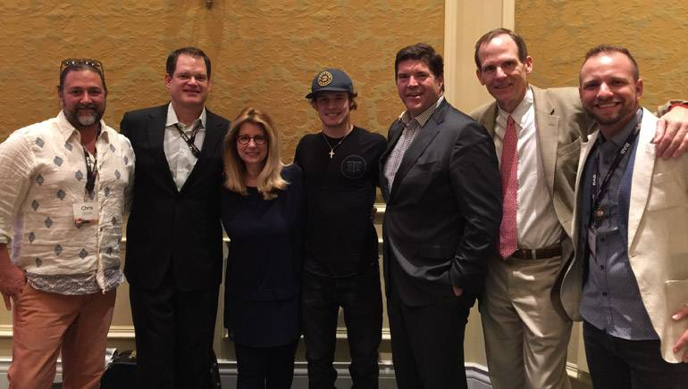 Pictured (L-R) after Tucker's performance are: Dot Records General Manager Chris Stacey,iHeart Media President of Corporate Operations & Northeast Division and RAB Board Chair Hartley Adkins, RAB President Erica Farber, BMI songwriter Tucker Beathard, Commonwealth Broadcasting President and BMI Board Member Steve Newberry, Dot Records Director of Southeast Promotion AJ Calvin and BMI's Dan Spears.