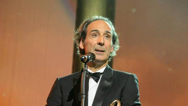 Award-winning composer Alexandre Desplat with his coveted Max Steiner Award.