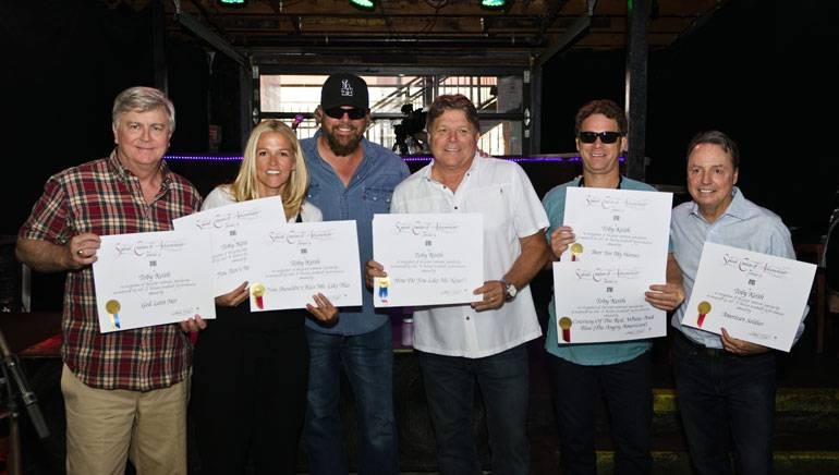 Pictured: (L-R): BMI's Phil Graham and Leslie Roberts, BMI singer-songwriter Toby Keith, BMI's David Preston, BMI songwriter Scotty Emerick and BMI's Jody Williams pose together after the presentation of Million-Air awards to Toby. The seven songs awarded totaled 23 million radio plays.